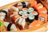 Set of sushi rolls on a wooden ship. Creative serving dishes. Menu. © Sergei Dvornikov