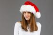 Beautiful woman in Santa Claus hat