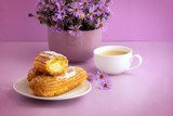 appetizing cakes on a lilac background