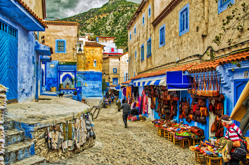 Street with stairs in Medina of Chefchaouen, Morocco. Chefchaouen or Chaouen is known that the houses in this old town are painted in the striking, variously blue hued © imadtouil