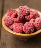 frozen organic raspberries in a bowl