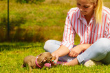 Woman playing with little dog outside © Voyagerix