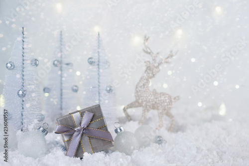 Gray silver gift box and Christmas decorations on a frosty winter background. © Iryna