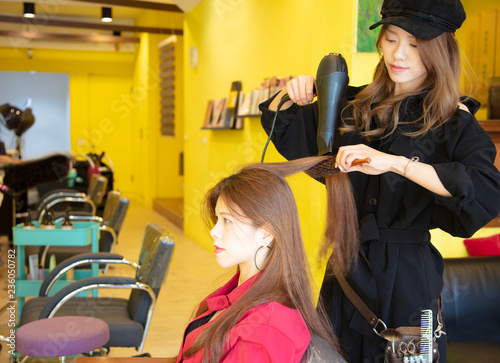 young hairdresser  working in hair salon