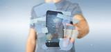 Businessman holding a Messages bubbles surrounding a smartphone 3d rendering