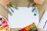 several paintbrushes with paint on a table - 236069772