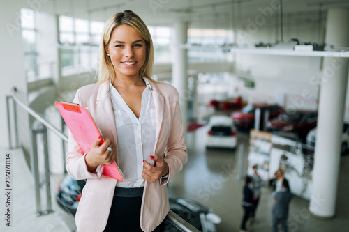 Leinwandbild Motiv Picture of professional salesperson working in car dealership
