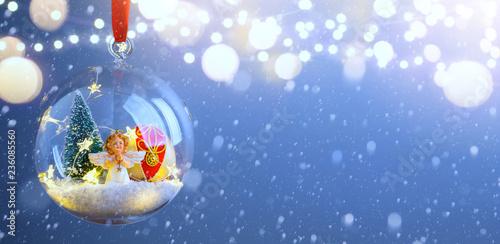 Foto Murales Christmas tree light; Blue Snowy winter Christmas Landscape
