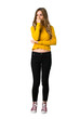A full-length shot of a young girl with yellow sweater having doubts on isolated white background