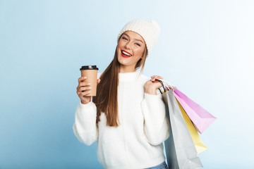Happy young woman wearing sweater standing