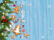 Holiday card with fir tree and festive decorations balls, stars, snowflakes and gingerbreads on wood background.