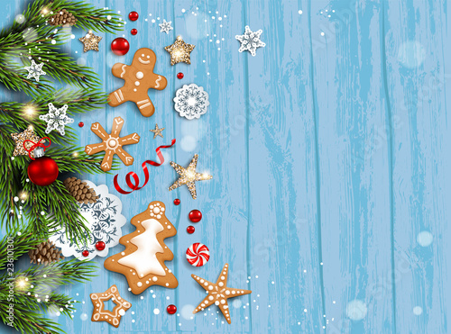 Holiday card with fir tree and festive decorations balls, stars, snowflakes and gingerbreads on wood background. - 236101301