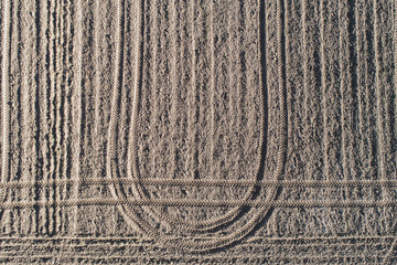 Plowed earthy field, dirt background.