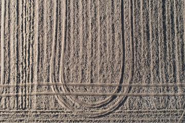 Plowed earthy field, dirt background.
