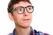Close up of man thinking while wearing eyeglasses