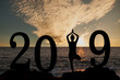 Leinwandbild Motiv New year 2019 yoga concept woman pose