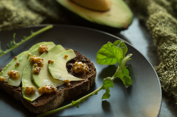 Rye bread with avocado and mustard seeds