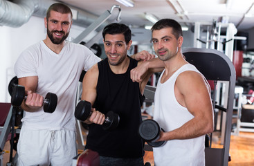 Three male friends in gym