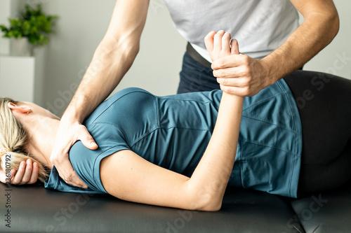 Leinwandbild Motiv A Modern rehabilitation physiotherapy man at work with woman client