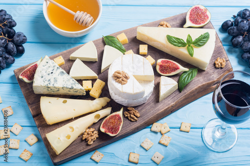 Cheeseboard with cheese brie , parmesan , camembert and dorblu . Food on wooden board - 236184508