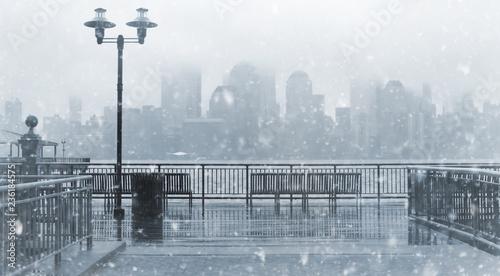 Leinwandbild Motiv Toned photo of New York City skyline on a snowy day