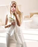 Smart blond lady smelling a rose - 236186543