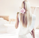 Backside portrait of a blond lady in a luxurious apartment - 236186550