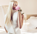 Backside portrait of a blond lady in a luxurious apartment - 236186561