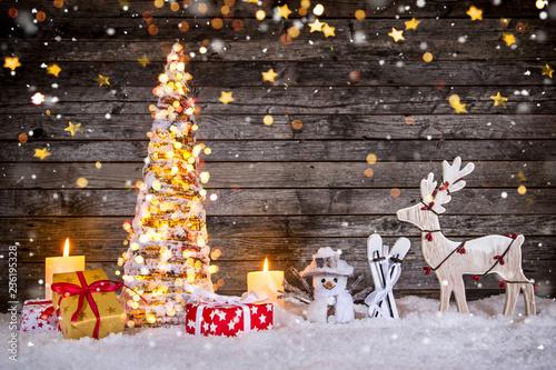 Leinwanddruck Bild Christmas tree decoration on wooden background