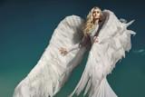 Portrait of an elegant, blond angel - 236195914