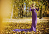 Elegant, sensual woman walking in the autumnal forest - 236195960