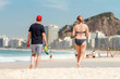 Quadro Couple of middle-aged people walking on Copacabana beach (Rio de Janeiro, Brazil)