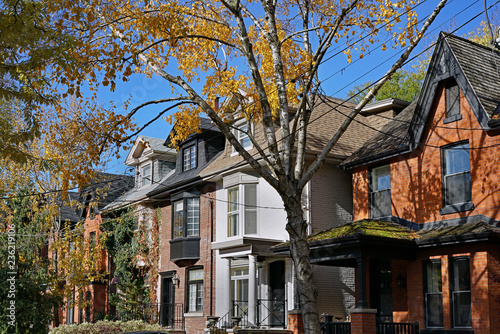 row of old Victorian houses with gables