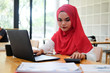 Quadro Islam woman working in cafe with portrait shot on table. Working woman concept.