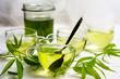 Leinwandbild Motiv Cannabis herbal tea served in glass teacups