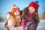 Little girl and her mother playing outdoors at sunny winter day - 236231781