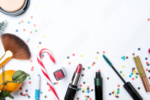 Leinwanddruck Bild Picture on top of eye shadows, brushes, sugar cane ,nail polish on white table