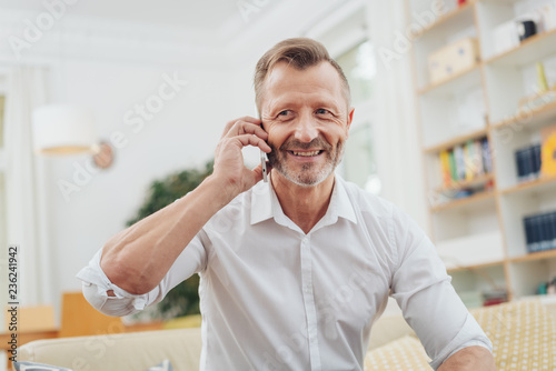 older man listening to a mobile call - 236241942