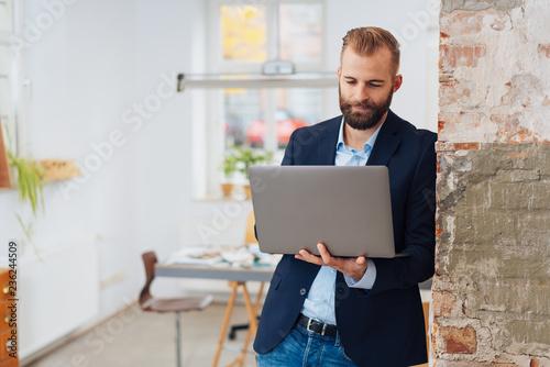 Stylish, modern entrepreneurial man with laptop