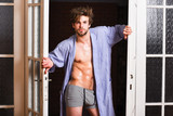 Guy attractive lover posing seductive. Sexy macho tousled hair coming out bedroom door. Seductive lover full of desire. Man lover near door. Sexy bachelor lover concept. That was great night