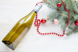 bottle of wine near christmas tree new year toys on white wooden background - 236264376