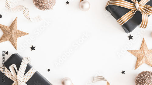 Christmas composition. Gifts, black and golden decorations on white background. Christmas, winter, new year concept. Flat lay, top view, copy space - 236268142