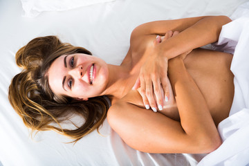 Naked woman in bed