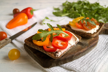 vegetarian food. rye bread with soft cheese and vegetables.