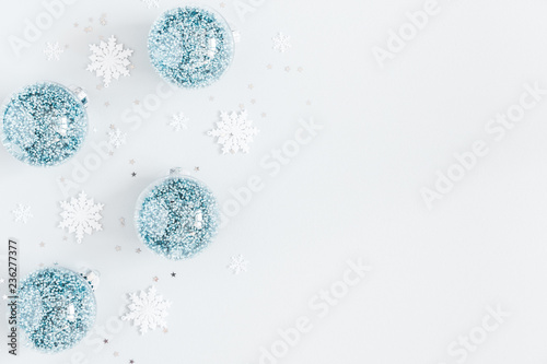 Christmas composition. Frame made of balls and snowflakes on pastel gray background. Christmas, winter, new year concept. Flat lay, top view, copy space