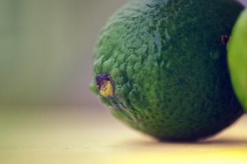 Dark green lemon close-up