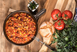Chili con carne in a clay pan. - 236280787