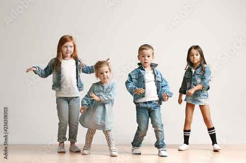 42561493d The portrait of cute little kids boy and girls in stylish jeans clothes  looking at camera