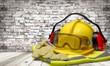 Leinwanddruck Bild - Safety helmet with earphones and goggles