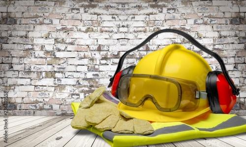 Leinwanddruck Bild Safety helmet with earphones and goggles